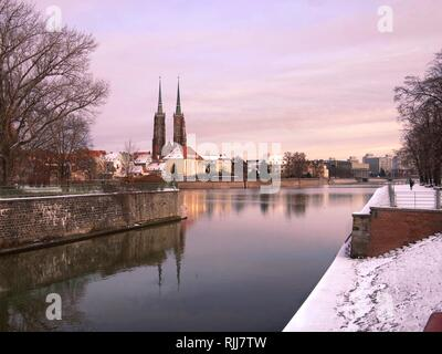 Odra or Oder River, Ostrow Tumski and St. John the Baptist Cathedral and Reflection in the Odra River,Wroclaw, Poland - Stock Photo