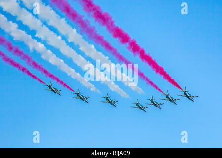 Abu Dhabi, United Arab Emirates, December 2, 2016: Al Fursan aerobatics team fly past in formation on National Day. - Stock Photo