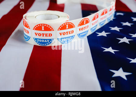 I voted today sticker, typical of US elections on American flag. - Stock Photo