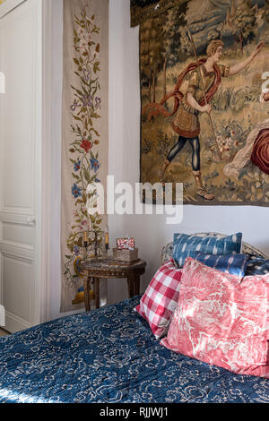 Rare 18th century wax resist indigo dye bedcover with Aubusson tapestry mid 19th century hand-painted silk panels - Stock Photo