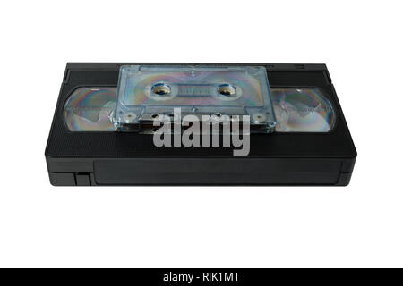 audio tape cassette and VHS video tape cassette isolated on white background. - Stock Photo