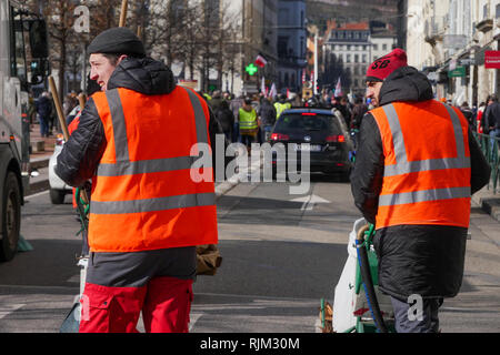 Municipal employees clean up the street after a demo, Lyon, France - Stock Photo