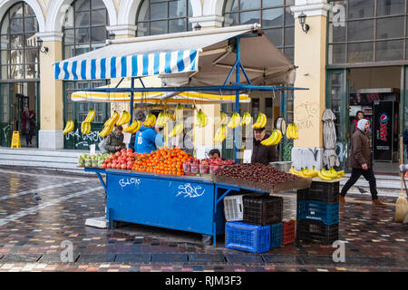 A fruit stand in the early morning after a rain storm in Monastiraki Square, Athens, Greece - Stock Photo