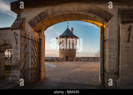 Tower in the courtyard in the evening - Stock Photo