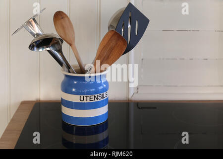 Kitchen appliance on a kitchen plate - Stock Photo