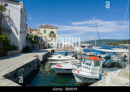 Boats in Valun harbour in the town of Valun,Cres Croatia - Stock Photo