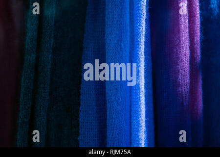 Close up of knitting texture. Knitted colourful fabrics at the clothing store - Stock Photo