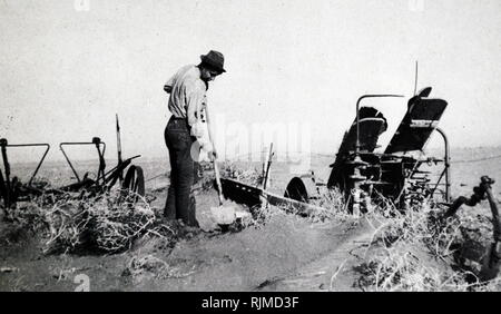 Farmer working during the Black Blizzard Dust Storm during the severe drought across the dust bowl in America 1934 - Stock Photo