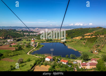 Rural landscape with Tirana, Albania in the background - Stock Photo