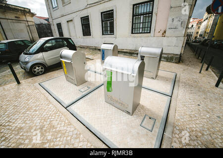 LISBON, PORTUGAL - FEB 10, 2018: View of separate waste containers with underground system on city street for glass, plastic, paper, metal - Stock Photo