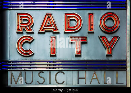 NEW YORK CITY, USA - JUL 16, 2010: Radio City Music Hall facade neon lettering in New York, a famous entertainment venue located in within Rockefeller - Stock Photo