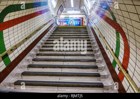London England United Kingdom Great Britain Westminster Piccadilly Circus Underground Station subway tube public transportation steps stairs subway ti - Stock Photo