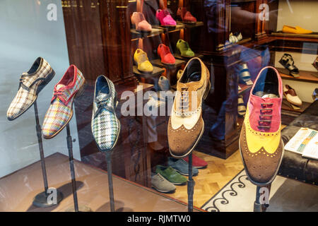 London England United Kingdom Great Britain Mayfair Piccadilly Burlington Arcade shopping upmarket luxury covered pedestrian arcade store men's shoes - Stock Photo