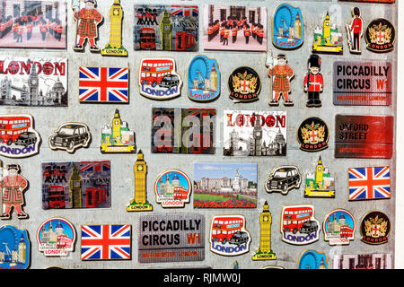 London England United Kingdom Great Britain West End Piccadilly street vendor souvenir kiosk shopping refrigerator magnets British icons display sale - Stock Photo