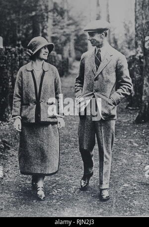 The future King George VI and Queen Elizabeth (Queen Mother) walking in a garden. Circa 1931