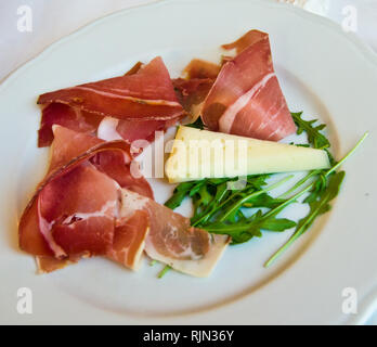 dish with excellent, lean and tasty ham with tasty cheese, perfect match for your buffet or your meal - Stock Photo
