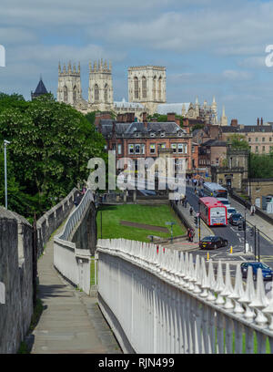 A portion of the city wall surrounding the old section of York, England. York Minster Cathedral is seen in the background. - Stock Photo