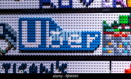 A Lego mosaic of the Uber logo made by a visitor at the Brickman experience exhibition - Stock Photo