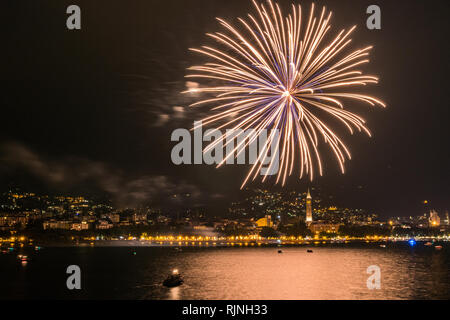 fireworks over the lake of como lecco during a summer night of party - Stock Photo