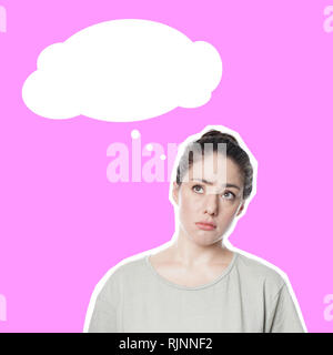 worried thoughtful young woman with concerned look on her face contemplating idea or problem - comic style cut out on pink background - empty thought bubble with copy space. - Stock Photo
