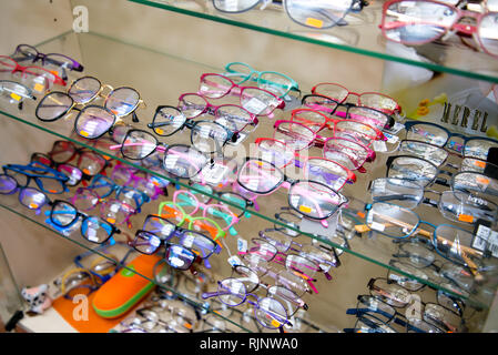 Chelyabinsk Region, Russia - February 2019. Showcase with glasses. Samples of multi-colored frames for glasses - Stock Photo