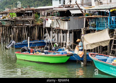 Houses on stilts and boats in the fishing village of Tai O on Lantau Island, Hong Kong, China, Asia. - Stock Photo