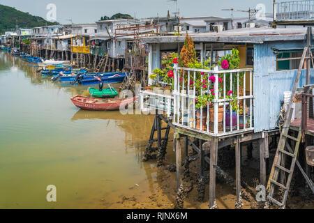 Houses on stilts and boats in the fishing village of Tai O on Lantau Island, Hong Kong, China, Asia. - Stock Photo