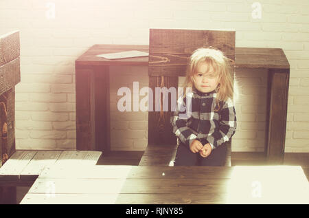 cute little boy with blonde hair in blue checkered shirt - Stock Photo