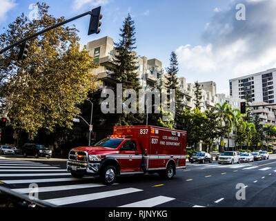Los Angeles, USA - July 29, 2018: Fire truck rides a call down the street in Los Angeles. - Stock Photo