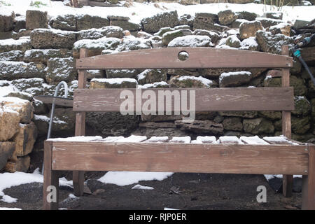On the tables and benches of the street cafe lies cold snow. WInter food concept - Stock Photo
