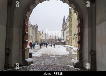 Ratusz, Main Town Hall, Renaissance style, 1556, seen through an arch in the Green Gate, in snowy weather, Długi Targ, Long Market, Gdańsk, Poland - Stock Photo