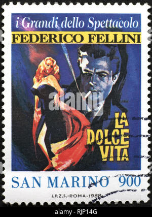 Movie La dolce vita by Fellini on postage stamp - Stock Photo