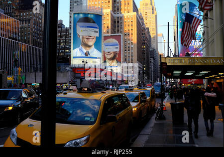 Late afternoon rush hour time at 7th Avenue near Penn Station and Madison Square Garden.Manhattan.New York City.New York.USA - Stock Photo