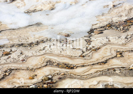 Close-up view of the Dead Sea shore seen from the Israeli border. - Stock Photo