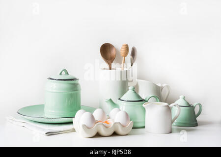 Crockery, tableware, utensils and other different white and turquoise stuff. Kitchen still life. - Stock Photo