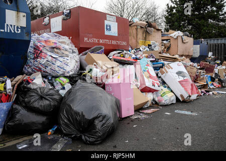 Post Christmas rubbish for recycling, piles up at the recycling point in Sainsburys car park on Gallaghers Retail Park, Tewksbury Road, Cheltenham  Pi - Stock Photo