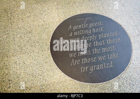 London, England. January 2018. 'A gentle guest, a willing host' plaque by John Betjeman poetry at St Pancras International Train Station - Stock Photo