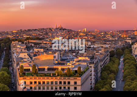 The Sacre-Cœur and Montmartre at sunset from the rooftop of the Arc de Triomphe ,Paris ,France - Stock Photo