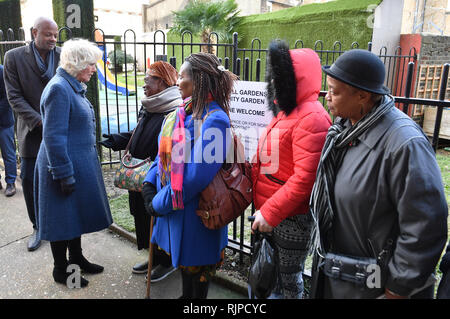 The Duchess of Cornwall meets the people who grow garden produce during a visit to the Lambeth GP Food Co-op Garden at Swann Mews, in Stockwell, London. - Stock Photo