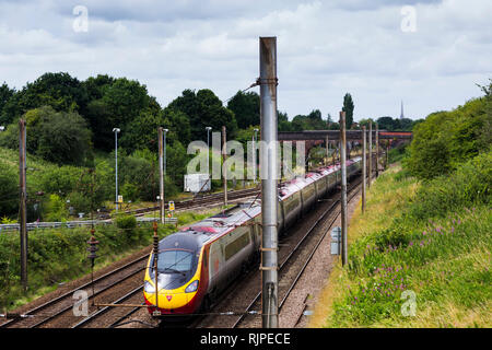 Virgin Pedolino express passenger train heading north on the West Coast Main Line, near Farington curve junction, Preston, Lancashire. - Stock Photo