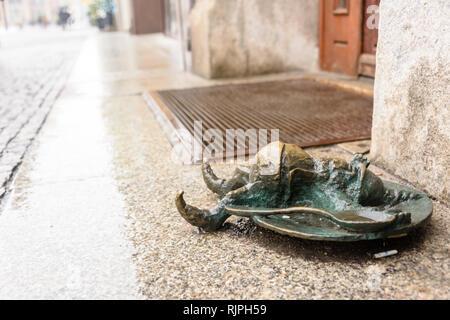 One of the brass gnomes (krasnale, krasnoludki) in Wrocław, Wroklaw, Poland - Stock Photo