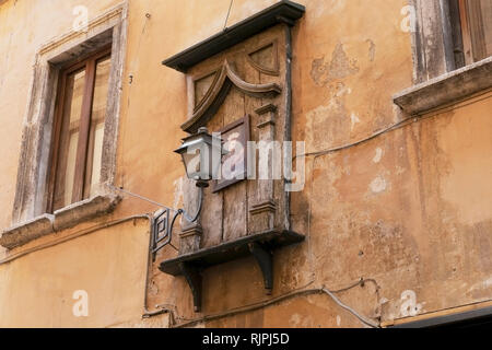 Madonna with lantern towed to a house in the old town of Rome, Italy - Stock Photo