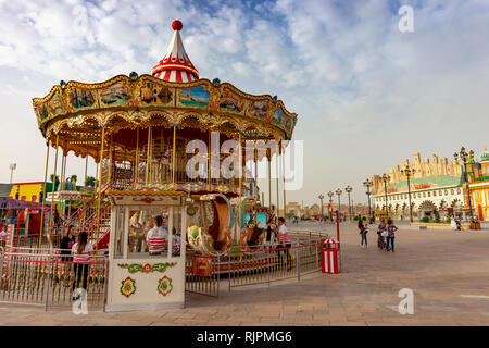 Dubai,UAE / 11. 06. : 2018 colorful decorated carousel merry go round in the global village - Stock Photo
