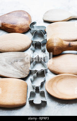 Close up of wooden spoons with Christmas cookie cutters - Stock Photo