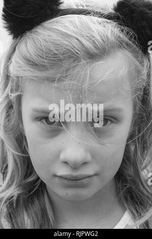 Black and white portrait of an unhappy, sad, hurting, preteen girl - Stock Photo