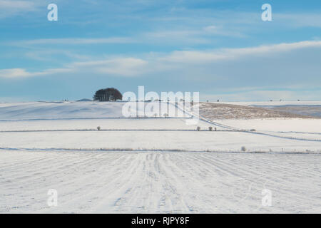 Snow covered winter landscape in Avebury, Wiltshire, England - Stock Photo
