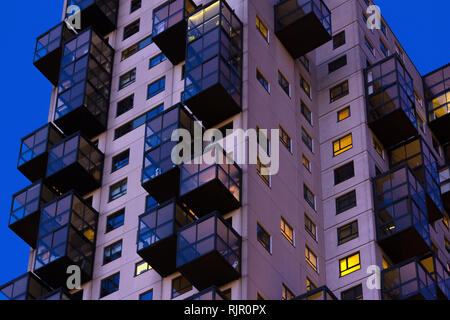 Late night view of council flats. Exterior of complex building in the city - Stock Photo