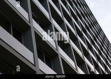 View of council flats. Exterior of complex building in the city. Urban environment - Stock Photo