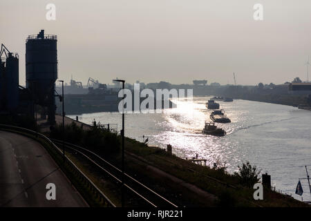 Freighters in the canal in the Duisburg port - Stock Photo