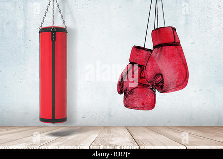3d rendering of red punching bag and boxing gloves on grey wall and white wooden floor background - Stock Photo